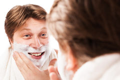 Close up of male shaving isolated over white. Background Stock Photography