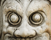 Close-up of male statue. Close-up of stone old male statue with protruding eyes Royalty Free Stock Images