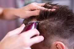 Close up of a male student having a haircut with hair clippers.  royalty free stock photos