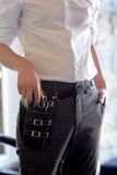 Close up of male stylist with tool case at salon stock image