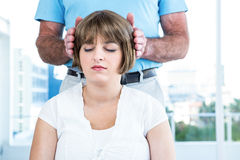 Close-up of male therapist performing reiki over woman. Close-up of male therapist performing reiki over women at health club Royalty Free Stock Photos