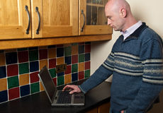 Close up of male using laptop in doors. Photo close up of male using laptop in doors Royalty Free Stock Images