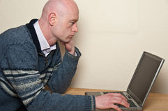 Close up of male using laptop in doors Royalty Free Stock Photo