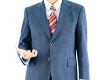 Male wearing blue in suit reaching hand out with clipping path. Close up, Male wearing blue in suit and red tie reaching hand out isolated with clipping path royalty free stock photo