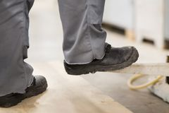 Close up of male worker feet in working shoes. People, footwear and work concept - close up of male worker feet in working shoes Stock Photo