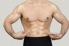 Close up on man abs. Royalty Free Stock Photo