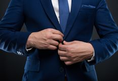Close-up man adjusting his  jacket button Royalty Free Stock Images