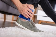 Man Applying Ice Gel Pack On An Ankle. Close-up Of A Man Applying Ice Gel Pack On An Injured Ankle royalty free stock images