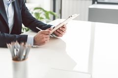Male hands keeping clipboard at desk stock photos