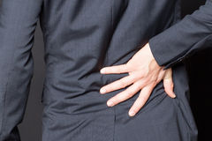 Close-up of man with back pain Stock Photo