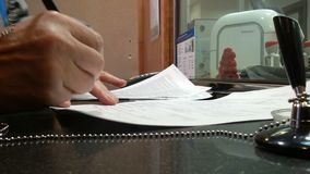 Close-up of a man in a bank signs a contract. stock video