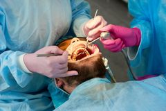 Close-up of man with beard during reception at dentist royalty free stock photo