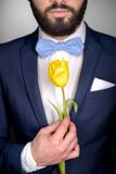 Close up of man with beard and tulip Stock Images