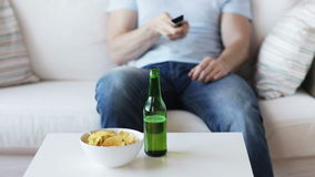 Close up of man with beer and remote at home stock video footage
