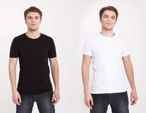 Close up of man in blank black and white t-shirt isolated on white background. Copy space and mock up. stock photography