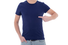 Close up of man in blank blue t-shirt pointing at himself. Isolated on white Royalty Free Stock Image
