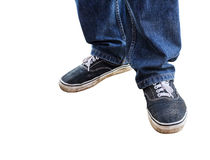 Close up a man in blue jeans standing on a white background Royalty Free Stock Image