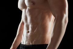 Close up of man or bodybuilder with bare torso Royalty Free Stock Images