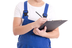 Close up of man builder in blue uniform writing something in cli Royalty Free Stock Images