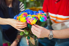 Close up man buys flowers in the flower shop Royalty Free Stock Photos