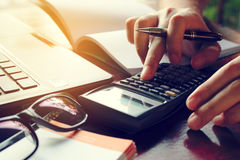 Close up man calculate cost on desk at home. Close up man calculate cost on desk at home Stock Image