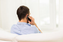 Close up of man calling on smartphone at home Royalty Free Stock Photography