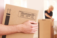 Close Up Of Man Carrying Box Into New Home Royalty Free Stock Photo