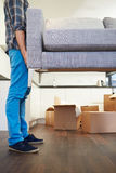 Close Up Of Man Carrying Sofa As He Moves Into New Home Stock Photography
