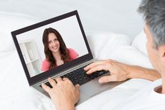 Close-up of a man chatting with woman stock image
