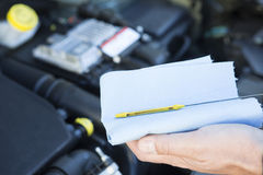Close-Up Of Man Checking Car Engine Oil Level On Dipstick Stock Image