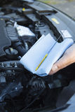 Close-Up Of Man Checking Car Engine Oil Level On Dipstick Stock Photos