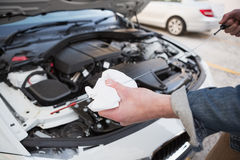 Close up of man checking car engine oil Stock Photos