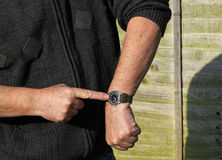 Close up man checking his watch. You are late. stock image
