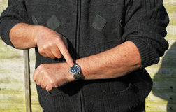 Close up man checking his watch. You are late. Stock Images