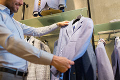 Close up of man choosing jacket at clothing store Stock Photo