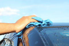 Close-up of a man cleaning car. Close-up of a man cleaning his car Royalty Free Stock Photos