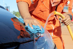 Close-up of a man cleaning car Stock Images