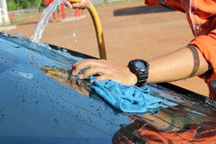 Close-up of a man cleaning car. Close-up of a man cleaning his car Royalty Free Stock Photography