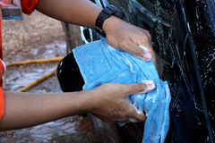 Close-up of a man cleaning car Stock Image