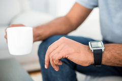 Close-up of man on coffee break with smart watch Royalty Free Stock Photography