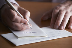 Close Up Of Man Completing Last Will And Testament Royalty Free Stock Photo