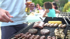 Close Up Of Of Man Cooking On Barbeque At Home