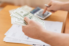 Close up of man counting money and making notes Stock Image