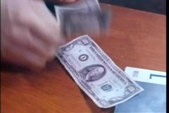 Close-up of man counting out five one hundred dollar bills stock footage