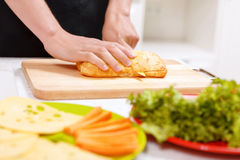 Close up of man cutting bread Royalty Free Stock Images