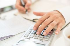 Close up man  doing finance at home office with calculate expens. Es Stock Photography