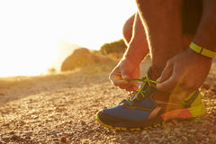 Close up of a man doing up his running shoes Stock Images