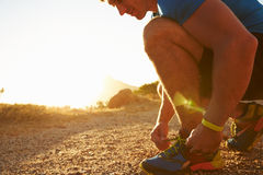 Close up of a man doing up his running shoes Royalty Free Stock Photography