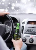 Close up of man drinking alcohol while driving car Royalty Free Stock Photos
