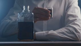 Close-up man drinking alcohol from glass alone in a bar. Concept of alcoholism. Close up man drinking alcohol from glass alone in a bar. Concept of alcoholism stock footage